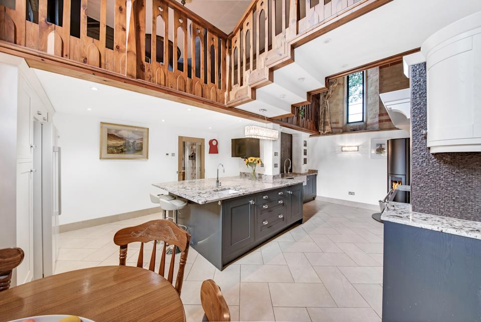 The galleried kitchen has granite work tops and on trend shaker style units. (Simon Blyth Estate Agents, Kirkburton via OnTheMarket)
