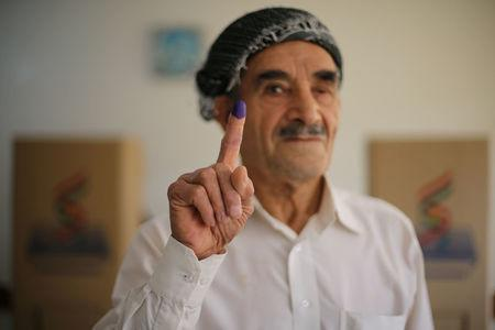 A man shows his ink-stained finger during Kurds independence referendum in Erbil, Iraq September 25, 2017. REUTERS/Ahmed Jadallah