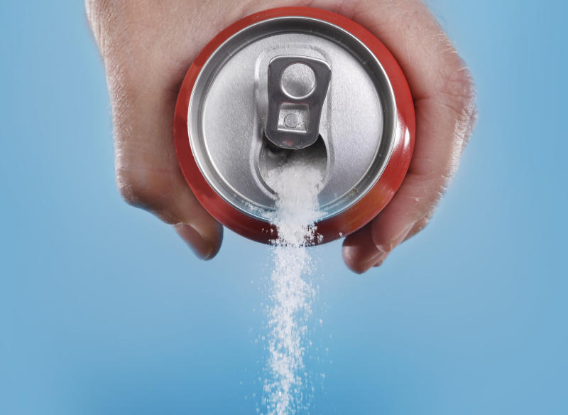 Coke with sugar being poured out