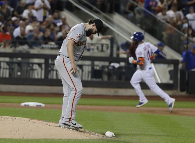 San Francisco Giants' Casey Kelly waits as New York Mets' Jose Bautista runs the bases after hitting a home run during the fourth inning of a baseball game Wednesday, Aug. 22, 2018, in New York. (AP Photo/Frank Franklin II)
