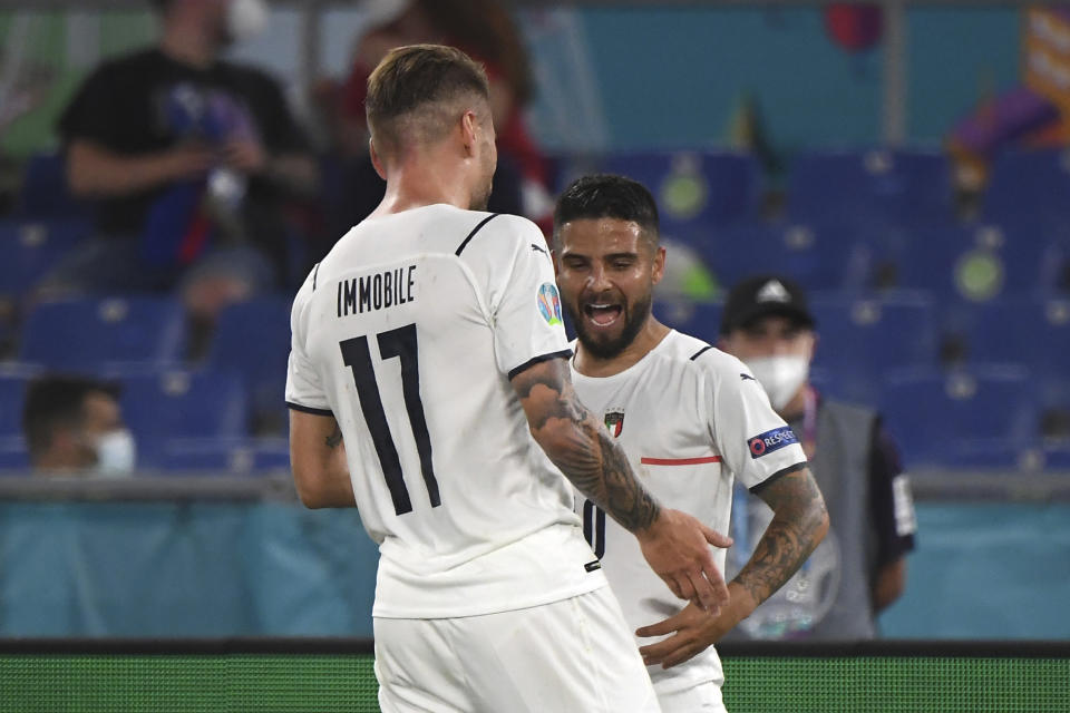 Italy's Lorenzo Insigne, right, celebrates with Italy's Ciro Immobile after scoring his side's third goal during the Euro 2020 soccer championship group A match between Italy and Turkey at the Olympic stadium in Rome, Friday, June 11, 2021. (Alberto Lingria/Pool Photo via AP)
