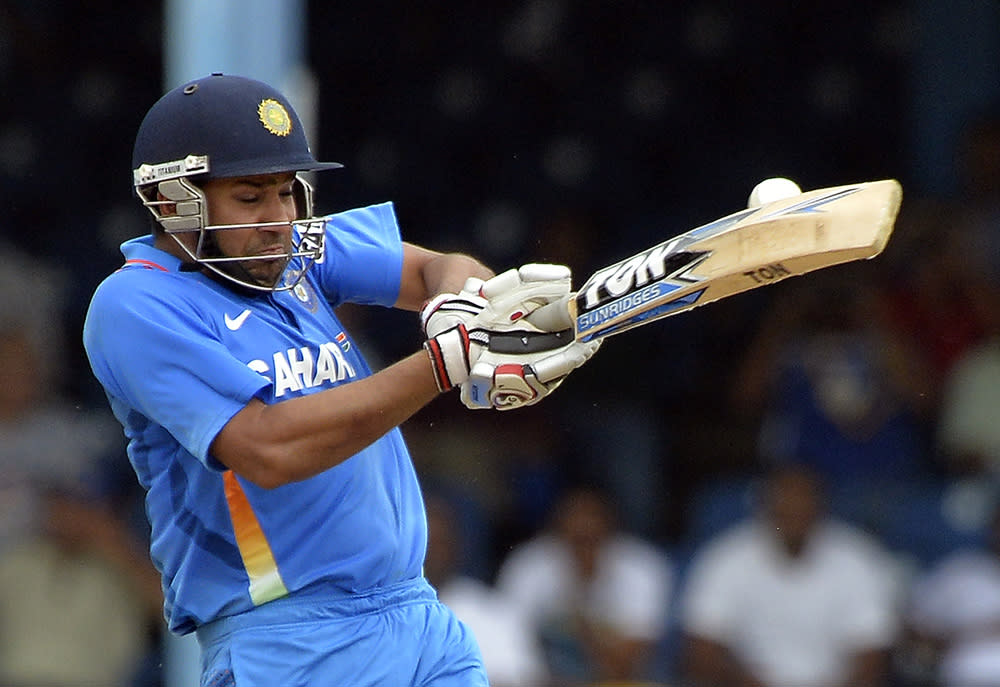 Indian cricketer Rohit Sharma plays a shot during the final match of the Tri-Nation series between India and Sri Lanka at the Queen's Park Oval stadium in Port of Spain on July 11, 2013. Sri Lanka have scored 201/10. AFP PHOTO/Jewel Samad