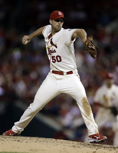St. Louis Cardinals starting pitcher Adam Wainwright throws during the ninth inning in the second game of a baseball doubleheader against the San Francisco Giants, Saturday, June 1, 2013, in St. Louis. Wainwright threw a complete game in the 7-1 win. (AP Photo/Jeff Roberson)