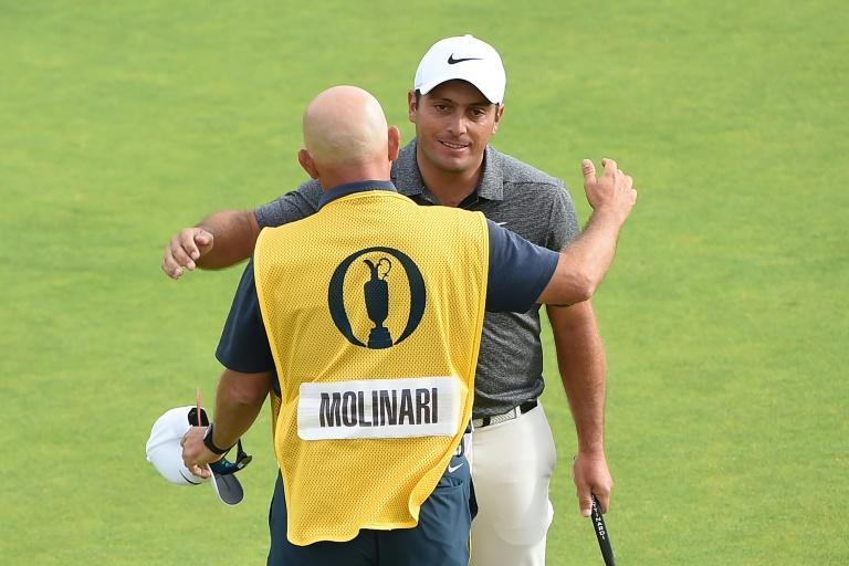 Francesco Molinari embraces his caddie on the 18th green at the end of his final round at Carnoustie on Sunday