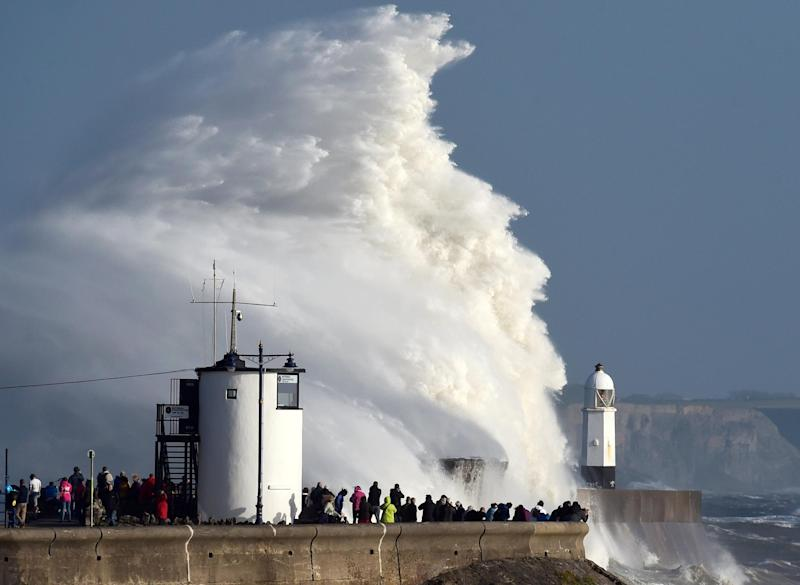 Waves crash over a lighthouse as Storm Ophelia passes Porthcawl. UK storms do cause damage and distress, but now they are being elevated into a big worry on a regular basis: Reuters