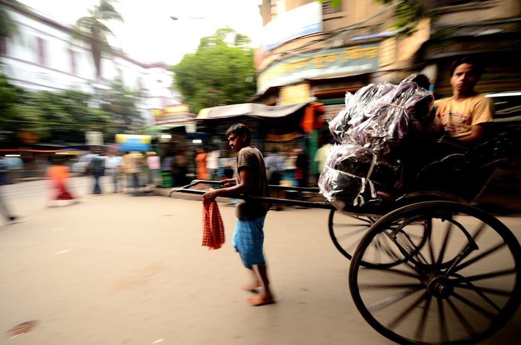 Hand-pulled rickshaws, a throwback to the past, are still common in Kolkata.