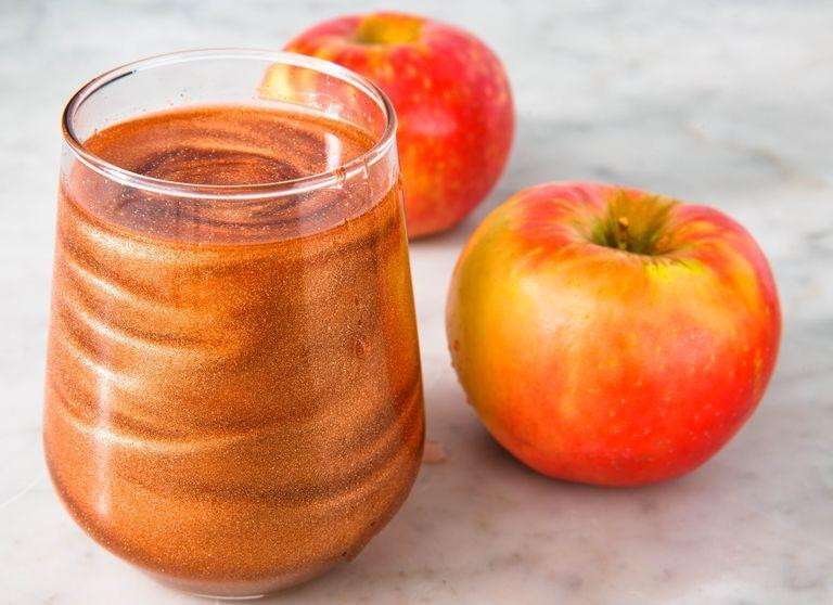"""<p>This super shiny drink contains edible glitter, so go ahead and drink up!</p><p><em>Get the recipe from <a href=""""https://www.delish.com/cooking/recipe-ideas/a23878264/poison-apple-cocktails-recipe/"""" rel=""""nofollow noopener"""" target=""""_blank"""" data-ylk=""""slk:Delish"""" class=""""link rapid-noclick-resp"""">Delish</a>. </em></p>"""