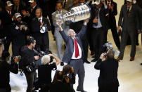 FILE - Chicago Blackhawks' head coach Joel Quenneville hoists the Stanley Cup after defeating the Tampa Bay Lightning in Game 6 of the NHL hockey Stanley Cup Final series in Chicago, in this Wednesday, June 10, 2015, file photo. Year 2 of the Joel Quenneville coaching era Florida has the Panthers looking very much like a Stanley Cup contender. At the midpoint of this season, the Panthers are 19-5-4, tied for the most points in the NHL entering Tuesday, March 16, 2021, and off to the best 28-game start in their history. (AP Photo/Charles Rex Arbogast, File)