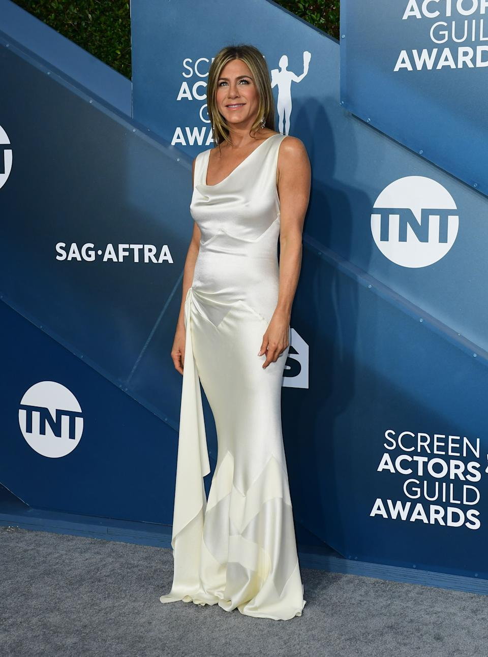 """<h2>Jennifer Aniston in Dior</h2><br>Breaking News: Jennifer Aniston <em>isn't</em> wearing black for once — and we're loving the result. <span class=""""copyright"""">Photo by FREDERIC J. BROWN/AFP via Getty Images.</span>"""