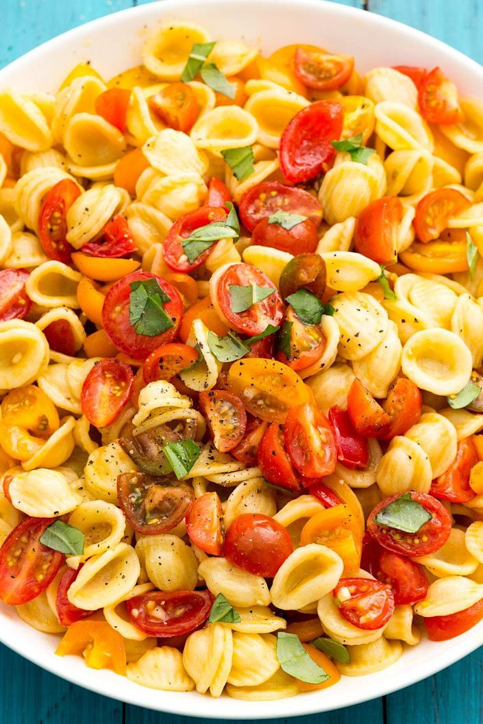 """<p>This salad is the epitome of summer in a bowl.</p><p>Get the recipe from <a href=""""https://www.delish.com/cooking/recipe-ideas/recipes/a47335/bruschetta-pasta-salad-recipe/"""" rel=""""nofollow noopener"""" target=""""_blank"""" data-ylk=""""slk:Delish"""" class=""""link rapid-noclick-resp"""">Delish</a>.</p>"""