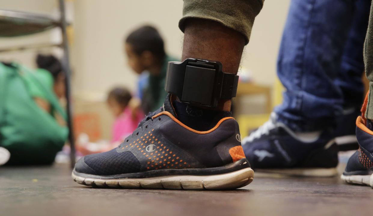 "<span class=""s1"">A Honduras immigrant seeking asylum, Carlos Fuentes Maldonado, who was released and reunited with his family, wears an ankle monitor as he waits at a Catholic Charities facility in San Antonio on Monday. (Photo: Eric Gay/AP)</span>"