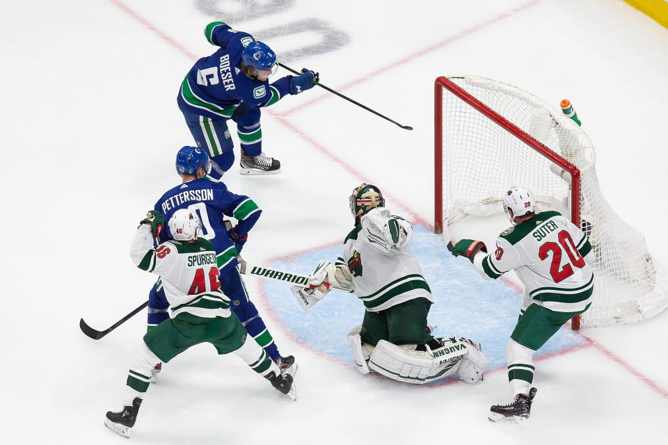 Minnesota Wild goaltender Alex Stalock (32) can't stop Vancouver Canucks' Brock Boeser (6) from scoring during the second period of an NHL hockey playoff game in Edmonton, Alberta, Tuesday, Aug. 4, 2020. (Codie McLachlan/The Canadian Press via AP)