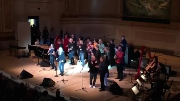 """Watch Patti Smith, Sufjan Stevens, Iggy Pop, Philip Glass, Laurie Anderson, New Order, Alabama Shakes, Ben Harper, & Tibetan Monks Sing """"People Have The Power"""" At Carnegie Hall"""