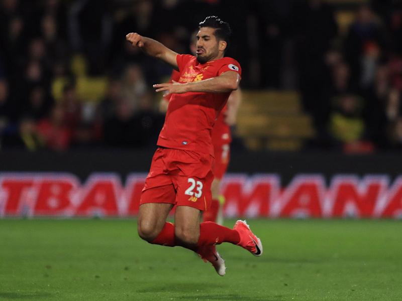Can celebrates his sublime first-half goal for Liverpool