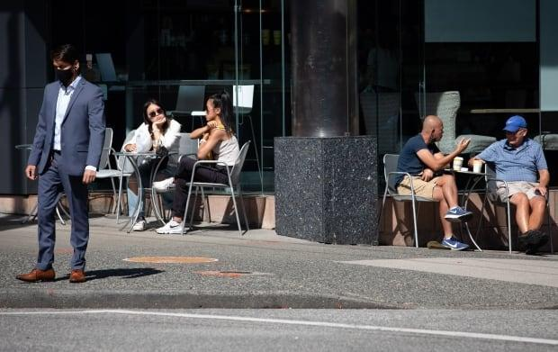 Café customers in downtown Vancouver on Sept. 7. (Maggie MacPherson/CBC News - image credit)