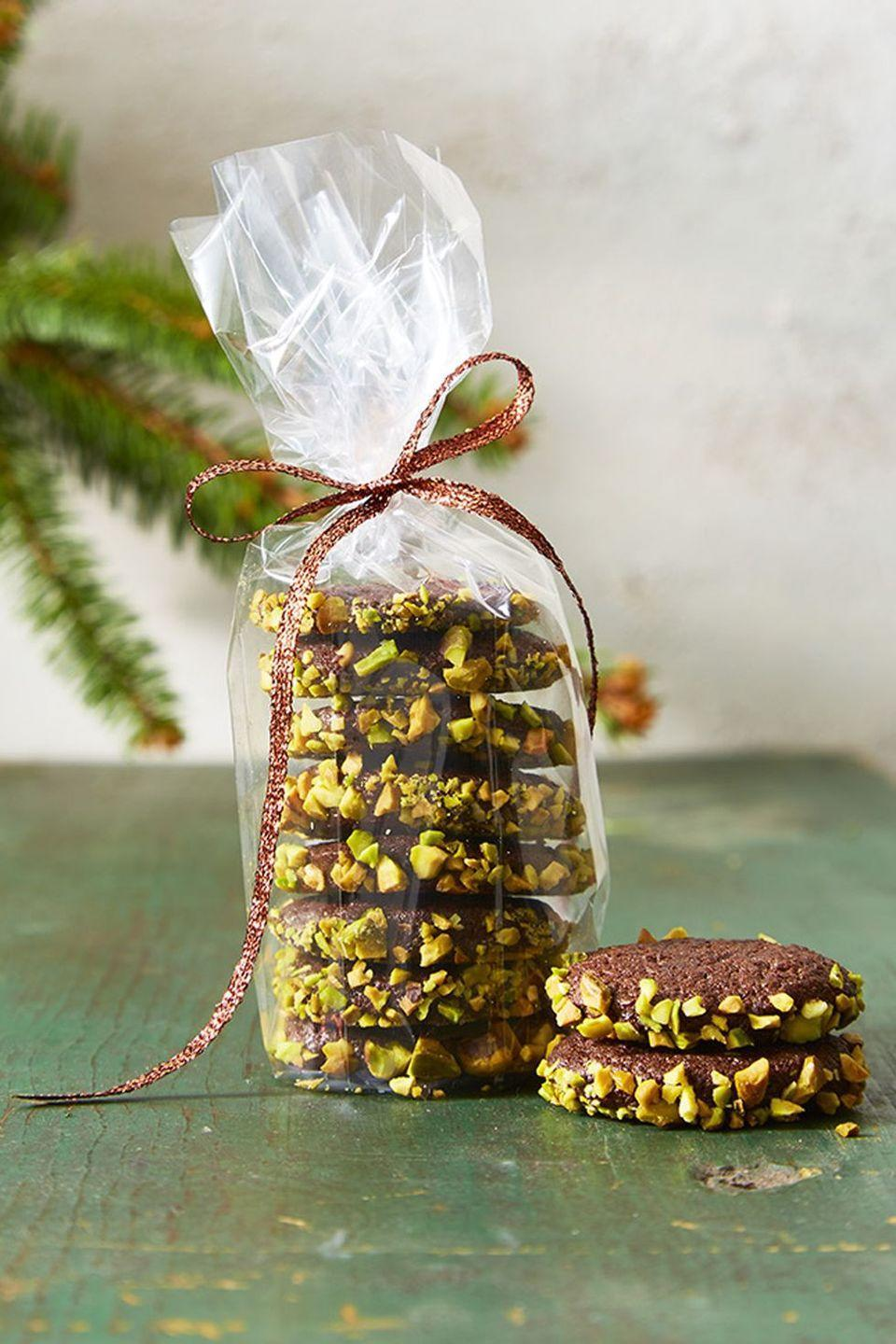 "<p>Roll logs of the chocolate cookie dough in pistachios, then slice and enjoy a sweet and salty bite (or two).</p><p><a href=""https://www.goodhousekeeping.com/food-recipes/dessert/a46923/slice-and-bake-chocolate-and-pistachio-cookies-recipe/"" rel=""nofollow noopener"" target=""_blank"" data-ylk=""slk:Get the recipe for Slice and Bake Chocolate and Pistachio Cookies »"" class=""link rapid-noclick-resp""><em>Get the recipe for Slice and Bake Chocolate and Pistachio Cookies »</em></a></p>"