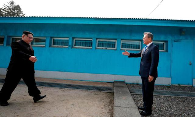 """<span class=""""element-image__caption"""">North Korea's leader Kim Jong-un crosses the border between to shake hands with South Korea's President Moon Jae-in </span> <span class=""""element-image__credit"""">Photograph: Korea Summit Press Pool/AFP/Getty Images</span>"""