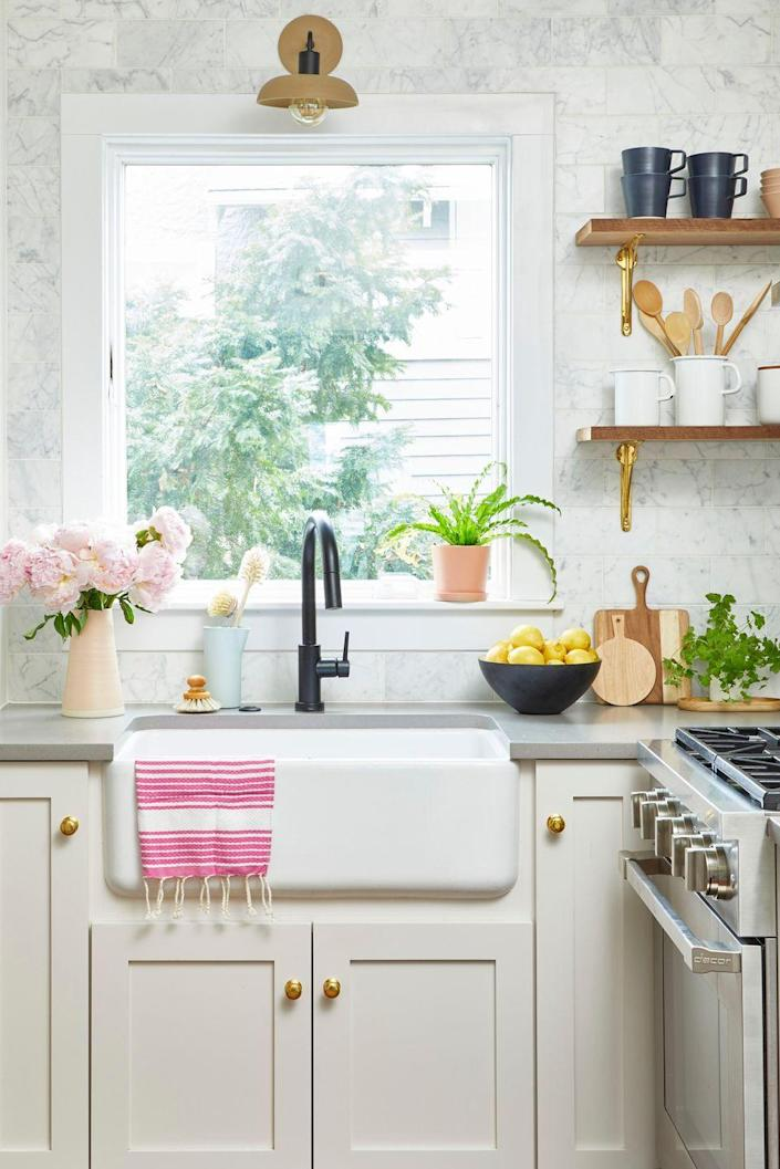 """<p>Unsightly kitchen grime is a mix of dust and grease that builds up over time. Run the exhaust hood over your range every time you cook to keep grease from settling. To de-gunk, use <a href=""""http://www.amazon.com/Parker-Bailey-Kitchen-Cabinet-Cream/dp/B000ETQMAO/?tag=syn-yahoo-20&ascsubtag=%5Bartid%7C10063.g.35370825%5Bsrc%7Cyahoo-us"""" rel=""""nofollow noopener"""" target=""""_blank"""" data-ylk=""""slk:Parker & Bailey Kitchen Cabinet Cream"""" class=""""link rapid-noclick-resp"""">Parker & Bailey Kitchen Cabinet Cream</a> because it cuts through dirt and leaves wood moisturized. Do an extra pass around any places that grease collects, like door and drawer pulls. </p><p><a class=""""link rapid-noclick-resp"""" href=""""https://www.amazon.com/Parker-Bailey-Kitchen-Cabinet-Cream/dp/B000ETQMAO?tag=syn-yahoo-20&ascsubtag=%5Bartid%7C10063.g.35370825%5Bsrc%7Cyahoo-us"""" rel=""""nofollow noopener"""" target=""""_blank"""" data-ylk=""""slk:SHOP CABINET CREAM"""">SHOP CABINET CREAM</a></p>"""