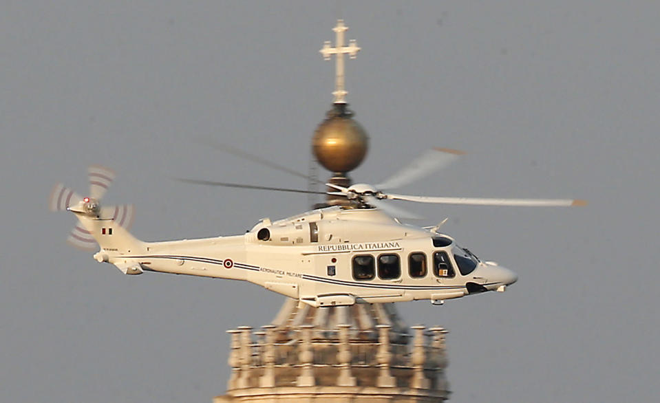 RETRANSMISSION OF SOB103 TO PROVIDE DIFFERENT CROP -- A helicopter with Pope Benedict XVI onboard leaves the Vatican in Rome, Thursday, Feb. 28, 2013. The 85-year-old German Pope Benedict is stepping down on Thursday evening, the first pope to do so in 600 years, after saying he no longer has the mental or physical strength to vigorously lead the world's 1.2 billion Catholics. (AP Photo/Michael Sohn)