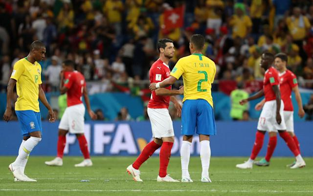 Soccer Football - World Cup - Group E - Brazil vs Switzerland - Rostov Arena, Rostov-on-Don, Russia - June 17, 2018 Switzerland's Blerim Dzemaili shakes hands with Brazil's Thiago Silva after the match REUTERS/Marko Djurica