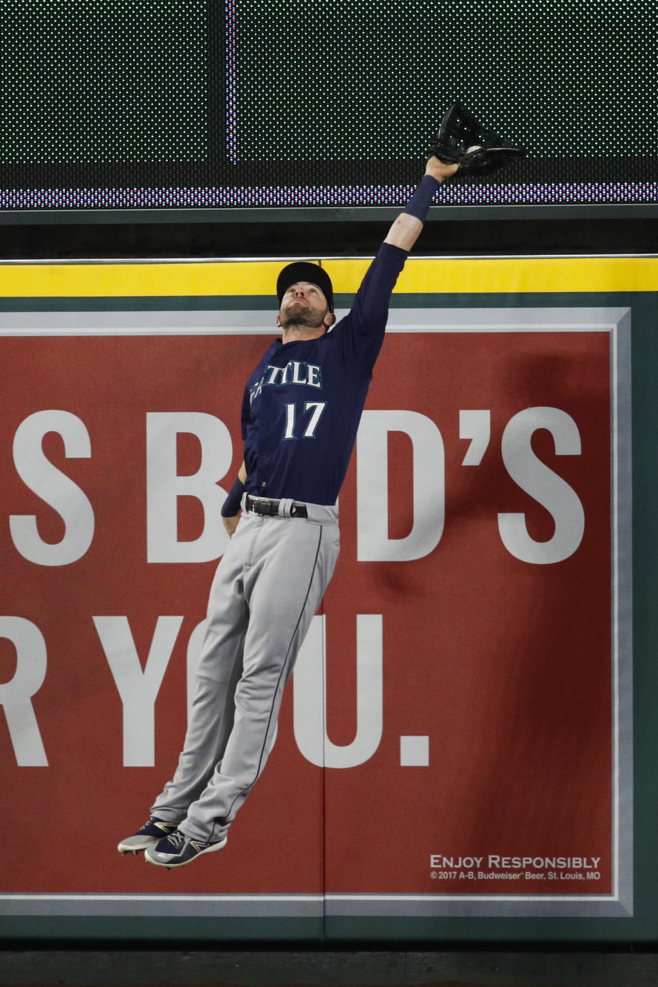 Seattle Mariners' Mitch Haniger leaps to catch the ball hit by Los Angeles Angels' Justin Upton during the sixth inning of a baseball game, Saturday, Sept. 15, 2018, in Anaheim, Calif. (AP Photo/Jae C. Hong)