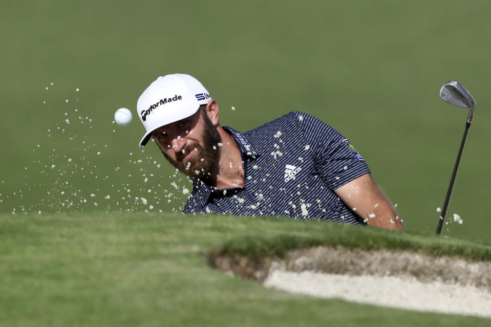 Dustin Johnson hits out of the bunker on the second hole during the final round of the Masters golf tournament Sunday, Nov. 15, 2020, in Augusta, Ga. (Curtis Compton/Atlanta Journal-Constitution via AP)