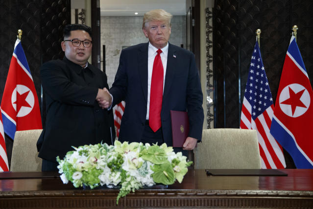 <p>President Donald Trump and North Korean leader Kim Jong Un shake hands during a signing ceremony during a meeting on Sentosa Island, Tuesday, June 12, 2018, in Singapore. (Photo: Evan Vucci/AP) </p>