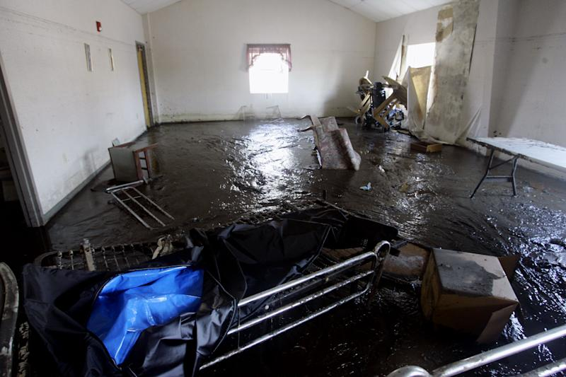 """FILE - This Sept. 16, 2005, file photo shows damage at St Rita's Nursing Home in St. Bernard's Parish, La., after Hurricane Katrina. Nearly seven years after the disaster exposed the vulnerability of nursing homes, serious shortcomings persist nationally. """"We identified many of the same gaps in nursing home preparedness and response,"""" investigators from the inspector general's office of the Department of Health and Human Services wrote in the report being released Monday, April 16, 2012. (AP Photo/Anja Niedringhaus, File)"""