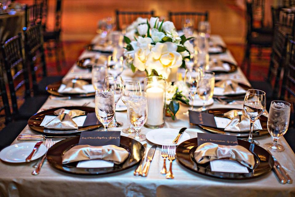 """<p>On New Year's Eve, you can never go wrong with classic black and white - with glimmering accents. It's a classic balance of femininity and masculinity, and in this New Year's soirée from <a rel=""""nofollow noopener"""" href=""""http://junebugweddings.com/wedding-blog/new-years-inspired-ojai-valley-wedding/"""" target=""""_blank"""" data-ylk=""""slk:Junebug Weddings"""" class=""""link rapid-noclick-resp"""">Junebug Weddings</a>, the high-gloss sheen of the napkins makes each place setting feel glam.</p>"""