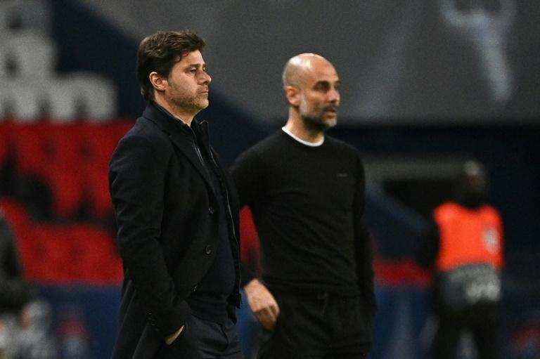 Manchester City manager Pep Guardiola (right)was rewarded for not making any surprise calls in his starting line-up against PSG
