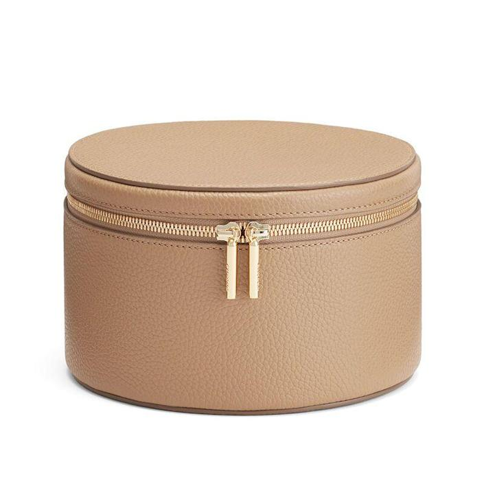 """<p>cuyana.com</p><p><strong>$185.00</strong></p><p><a href=""""https://go.redirectingat.com?id=74968X1596630&url=https%3A%2F%2Fwww.cuyana.com%2Fsmall-leather-goods%2Fwellness%2Fleather-wellness-case%2F10051034.html&sref=https%3A%2F%2Fwww.townandcountrymag.com%2Fstyle%2Fbeauty-products%2Fg19408606%2Fgift-ideas-for-women%2F"""" rel=""""nofollow noopener"""" target=""""_blank"""" data-ylk=""""slk:Shop Now"""" class=""""link rapid-noclick-resp"""">Shop Now</a></p><p>If she's a beauty junkie, give her the gift of some vanity organization with a leather wellness case. Organization and a luxe item for your counter top—what more could you ask for?</p>"""