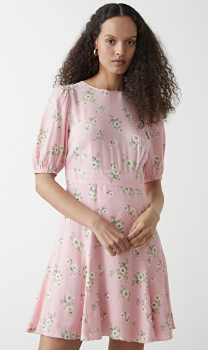 & Other Stories' Puff Sleeve Mini Dress comes in three other colours, as well as Holly's pink floral hue.  (& Other Stories)