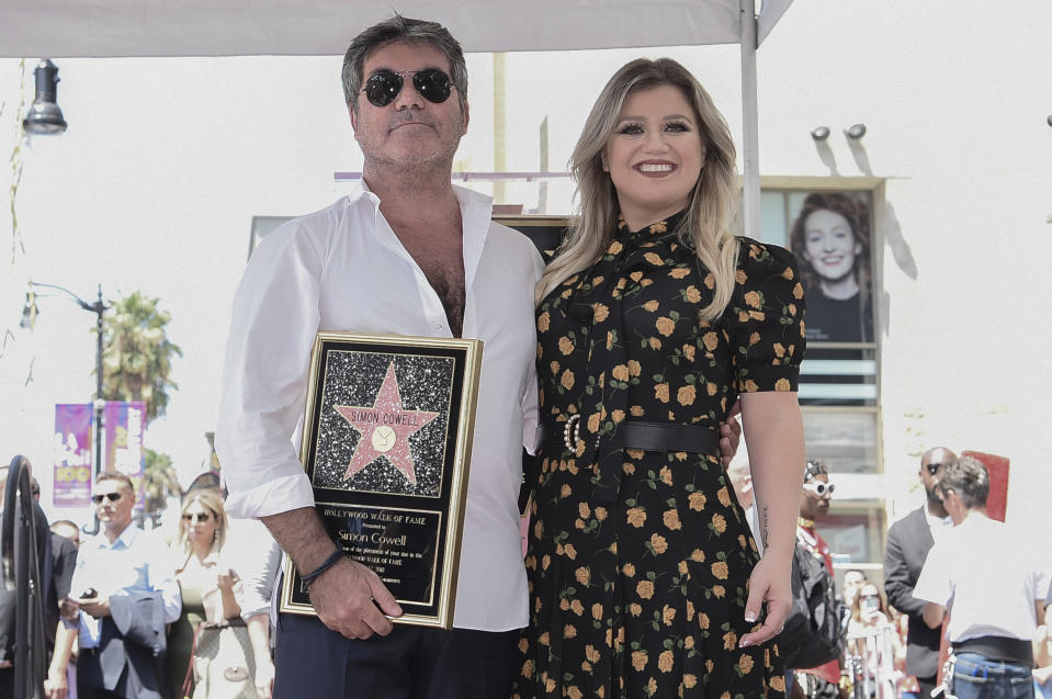 Simon Cowell, left, and Kelly Clarkson attend a ceremony honoring Cowell with a star on the Hollywood Walk of Fame on Wednesday, Aug. 22, 2018, in Los Angeles. (Photo by Richard Shotwell/Invision/AP)