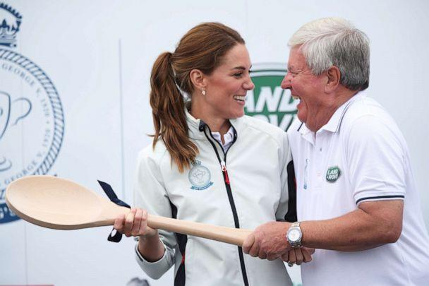 PHOTO: Catherine, Duchess of Cambridge, is seen awarded a wooden spoon during the prize giving after her boat came last in the King's Cup Regatta in Cowes, the Isle of Wight, Britain August 8, 2019. (Andrew Matthews/Pool via Reuters)
