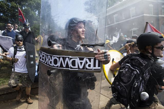 <p>White Supremacists rush forward with shields and sticks during clashes with counter protestors at Emancipation Park where the White Nationalists are protesting the removal of the Robert E. Lee monument in Charlottesville, Va., on Aug. 12, 2017. (Photo: Samuel Corum/Anadolu Agency/Getty Images) </p>
