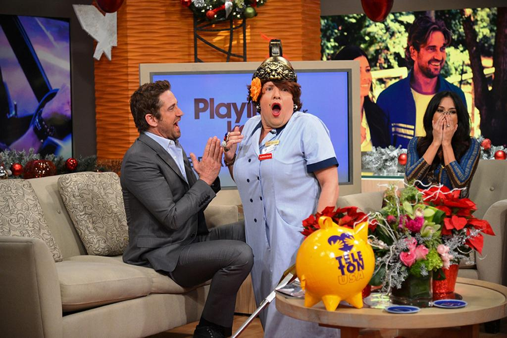 "MIAMI, FL - NOVEMBER 27:  In this handout image provided by Univision, DA personality Dona Meche (played by one of DA host Raul Gonzalez) is surprised by Gerard Butler on the set of ""Despierta America"" November 27, 2012 at Univision Studios in Miami, Florida.  Butler was promoting his new movie ""Playing For Keeps.""  (Photo by Univision via Getty Images)"
