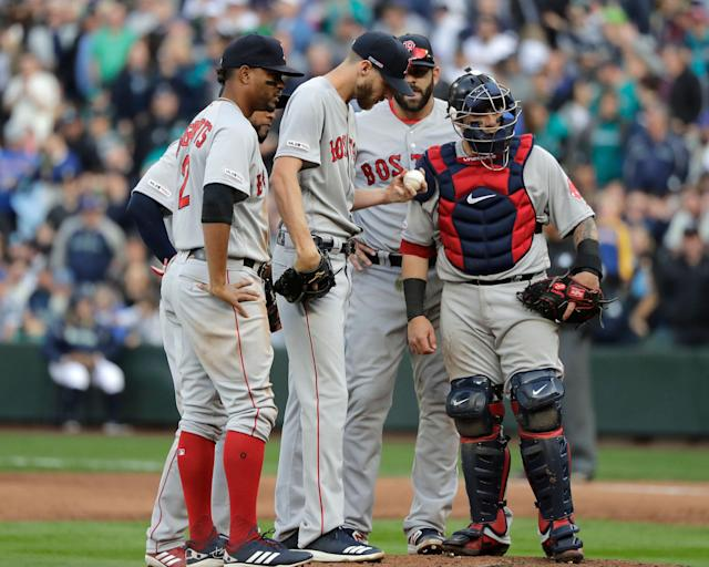 "<a class=""link rapid-noclick-resp"" href=""/mlb/players/8780/"" data-ylk=""slk:Chris Sale"">Chris Sale</a> (center) was not sharp on Opening Day at Seattle (AP/Ted S. Warren)"