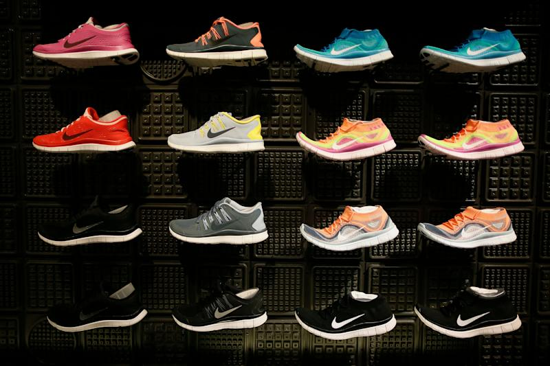 Shoes are displayed at the Nike store in Santa Monica, California, September 25, 2013. NIKE, Inc. plans to release its first quarter fiscal 2014 financial results on Thursday, September 26, 2013. REUTERS/Lucy Nicholson (UNITED STATES - Tags: BUSINESS SPORT)