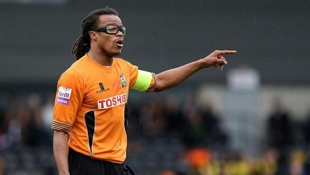 <p>In 2012, ageing Dutch midfielder Edgar Davids joined League Two side Barnet. He was placed in a player-manager role alongside Mark Robson. </p> <br><p>When Robson left the club in December 2012, Davids was placed solely in charge of the team and seemingly left to do what he wanted. The following season he announced he would wear the number one shirt.</p> <br><p>He said he wanted to start a trend of midfielders wearing the number traditionally worn by goalkeepers. It did not catch on.</p>