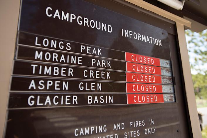 A sign shows that all campgrounds are closed in Rocky Mountain National Park near Estes Park, Colo. on Monday, May 18, 2020.