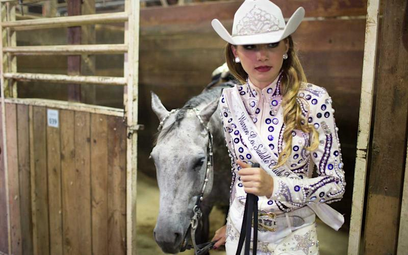 Elivia Papcun of Norwalk, IA prepares for the Cowgirl Queen contest on Friday. Papcun came in 2nd place last year and is hoping to bring home the gold (and scholarship money) after a year of training. | Jason Bergman