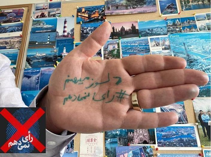 Iranians from across the country – and expats around the world – posted pictures of their palms ahead of the June 18, 2021 election, on which they'd written: