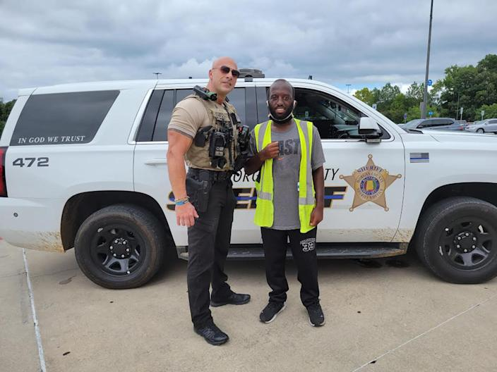 Fields, seen posing with a local fan named Tyler, has worked for the Morgan County Sheriff's Office for 17 years. (Morgan County Sheriff's Office)