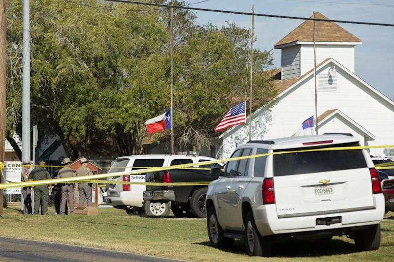 Law enforcement officials gather near the First Baptist Church in Sutherland Springs (Getty Images)