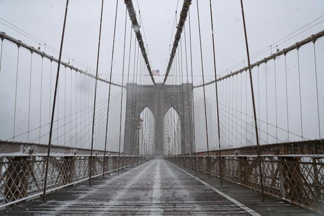 <p>A rare sight here in the Big Apple, the Brooklyn Bridge is empty as a spring storm hit the Northeast with strong winds on Wednesday, March 21, 2018. (Photo: Gordon Donovan/Yahoo News) </p>