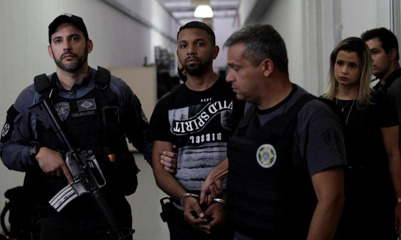 Rogério da Silva being arrested by police