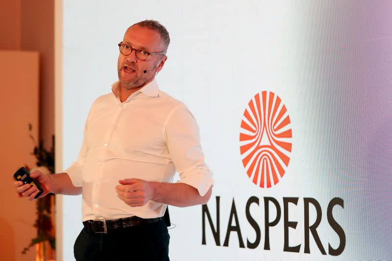 FILE PHOTO: Bob van Dijk, CEO of e-commerce group Naspers, gestures during a media briefing in Johannesburg