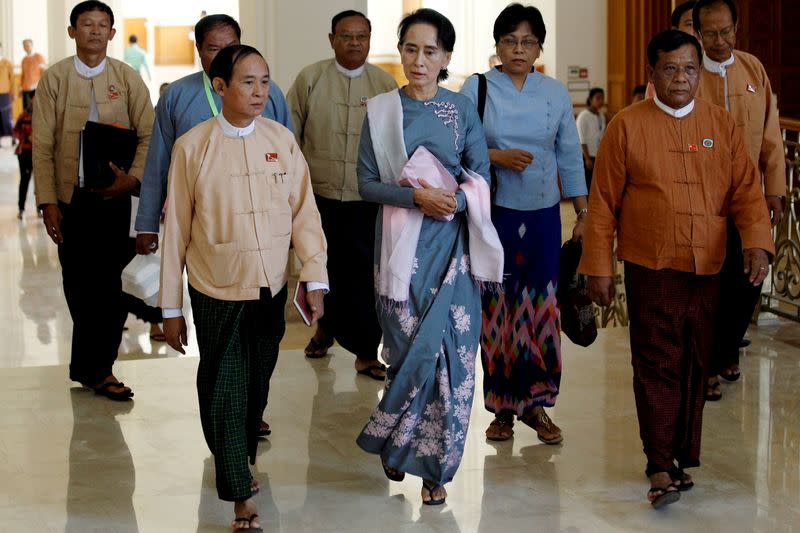 FILE PHOTO: Aung San Suu Kyi (C) arrives for Myanmar's first parliament meeting after the November 8 general elections, at the Lower House of Parliament in Naypyitaw