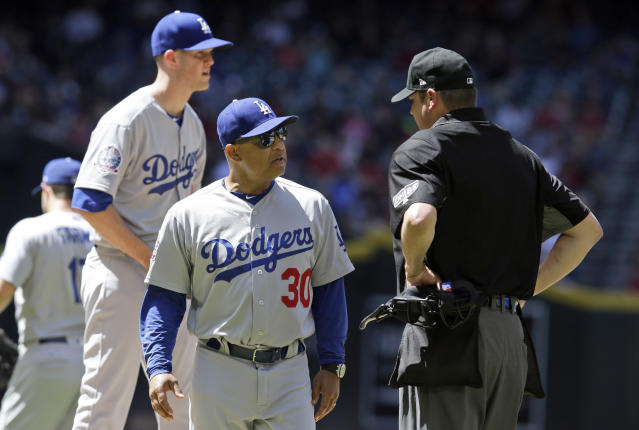 FILE - In this Thursday, May 3, 2018, file photo, Los Angeles Dodgers manager Dave Roberts (30) walks off the mound after a visit during the first inning during a baseball game against the Arizona Diamondbacks in Phoenix. One-quarter of the way into the season, the defending NL champion are off to their worst start in 60 years. Lately they're even losing to bad teams.(AP Photo/Rick Scuteri, FIle)