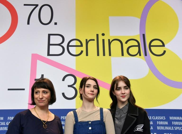 """(L-R) US film director Eliza Hittman, US actress Sidney Flanigan and US actress Talia Ryder highlight their film """"Never Rarely Sometimes Always"""" screened in competition at the 70th Berlinale film festival in Berlin"""
